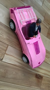Ken doll, with Barbie pink car.