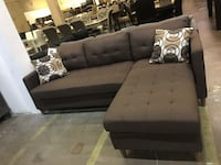 Reversible fabric sectional with pillows. Brand new.  Lewisville