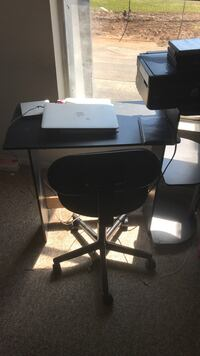 Black wooden desk and rolling chair 675 mi