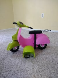pink and green scooter motorcycle ride on toy