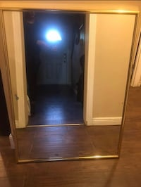 Large gold frame mirror with minor water damage. The mirror is heavy but has a good frame and wire on the back to support the mirror Indianapolis, 46226