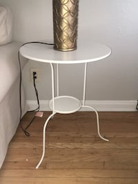 white and gray metal base chair