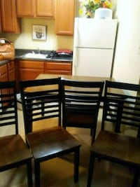 rectangular brown wooden table with six chairs din Shreveport, 71101