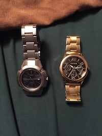 gold and black round geneva chronograph watch Calgary, T2G 2L3