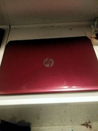 red and white HP laptop Reno