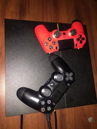 black Sony PS4 console with two controllers Washington, 20024