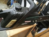 black and green craftsman chainsaw