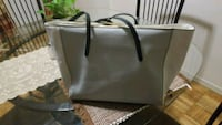 gray and black leather tote bag 540 km