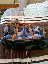 blue and brown monogram Coach leather handbag