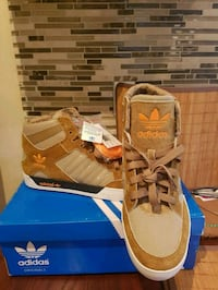 pair of brown Adidas high-top sneakers 550 km