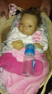 baby doll wearing white and pink dress Springfield, 62702