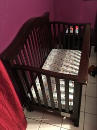 baby's brown wooden crib 933 mi