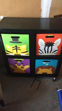 black, red, and green animals printed 4-slot cubby shelf