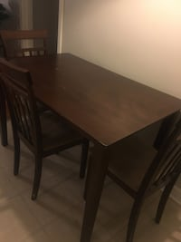 rectangular brown wooden table with four chairs dining set Lafayette, 70503