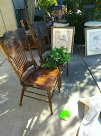 two brown wooden chairs with brown wooden bases Yuma, 85364