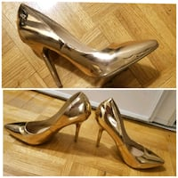 pair of golden leather pointed-toe pumps Toronto, M3A 2X1