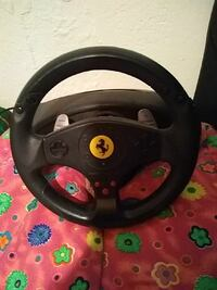 black and gray car steering wheel controller
