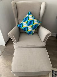Light beige arm chair with foot stool