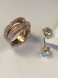 gold-colored rings with stud earrings