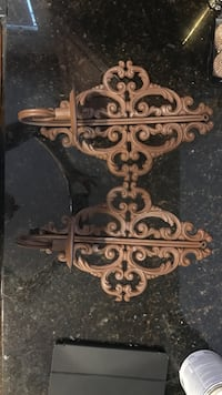 two brown metal candle holders