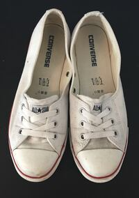pair of white Converse All-Star lace-up low-top casual sneaker
