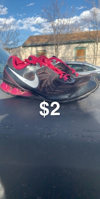 unpaired black and red Nike basketball shoe Albuquerque, 87102