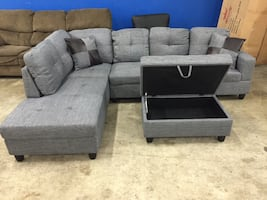 Grey fabric tufted sectional sofa and ottoman