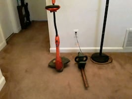 A NICE GRASSHOG WEED EATER WITH A BLACK AND DECKER TREE CUTTER...