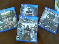 three assorted PS4 game cases null