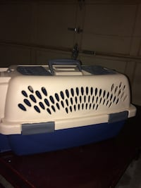 White and blue pet carrier