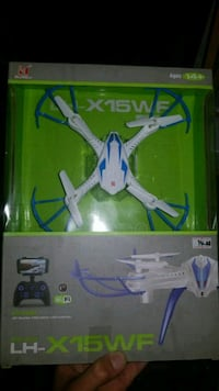 white and blue quadcopter drone with box Côte Saint-Luc, H3X 4A1