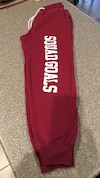 Maroon and white Squad Goals print pants... Size Med Jr