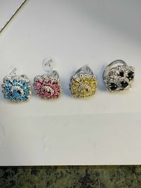 four blue, pink, yellow, and black beaded silver r