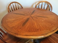 round brown wooden table with four chairs dining set 斯普林, 77386