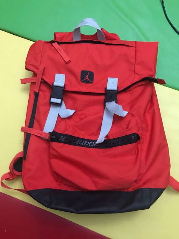 Big red back pack b0a0ffe3-c077-42b0-acb8-fd39bbc89d6a