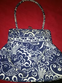 blue and white floral clutch bag