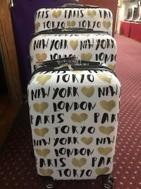 Three white-and-black printed hard shell luggage bags 라스베가스, 89102