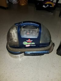 blue and black Bissell vacuum cleaner