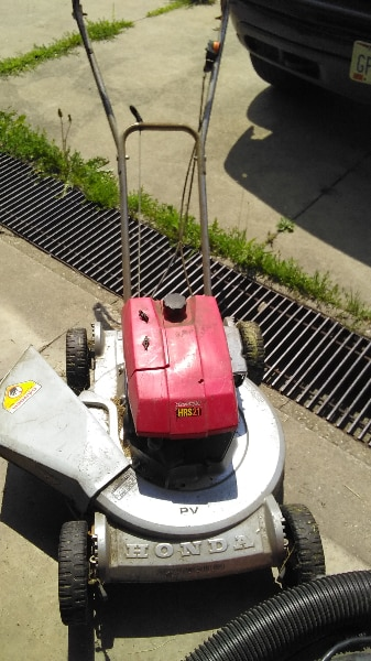 Red And Grey Honda Push Mower