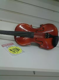 brown violin with bow in case Houston, 77037
