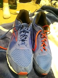 pair of gray-and-yellow Nike running shoes Winnipeg, R3M 1B4
