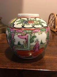 Multicolored monk themed floral ceramic pot Arlington, 22201