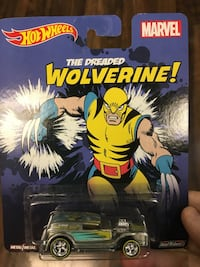 gray and black Hot Wheels Marvel Wolverine car die-cast model