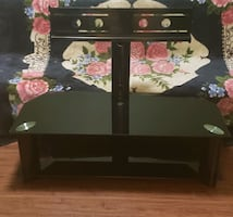 Flat panel black glass TV stand
