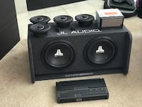 """Black jl audio 8 speaker system with 4 horns, 2 tweeters, a slotted kicker with 2 10"""" subs, a 500w amp and a Pioneer AVH4201NX CD/DVD receiver.  Renton, 98058"""
