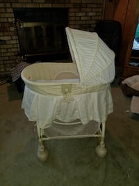 Baby's pale yellow bassinet