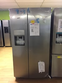BRAND NEW Frigidaire stainless steel side by side refrigerator