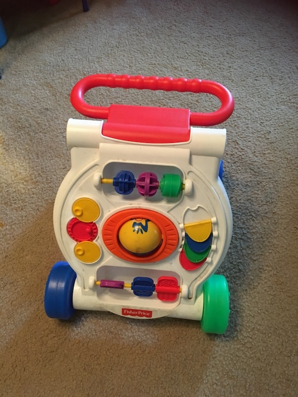 white, red, and green Fisher Price learning walker
