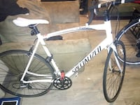 white and black Specialized road bike