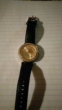 round gold analog watch with black leather strap